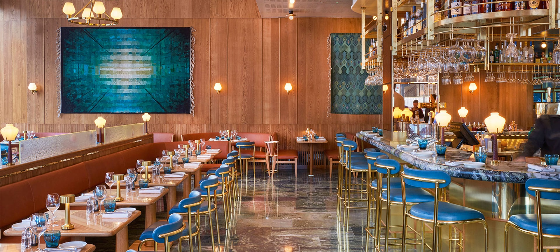 Aquavit - New York's two-Michelin-starred Scandinavian haven has opened its first outpost in London. Restaurant design king Martin Brudnizki was charged with revamping the space, which features a wall-mounted textile by Olafur Eliasson, silverware by Georg Jensen and furnishings by Svenskt Tenn. Naturally, the menu also remains faithful to the region's delights.
