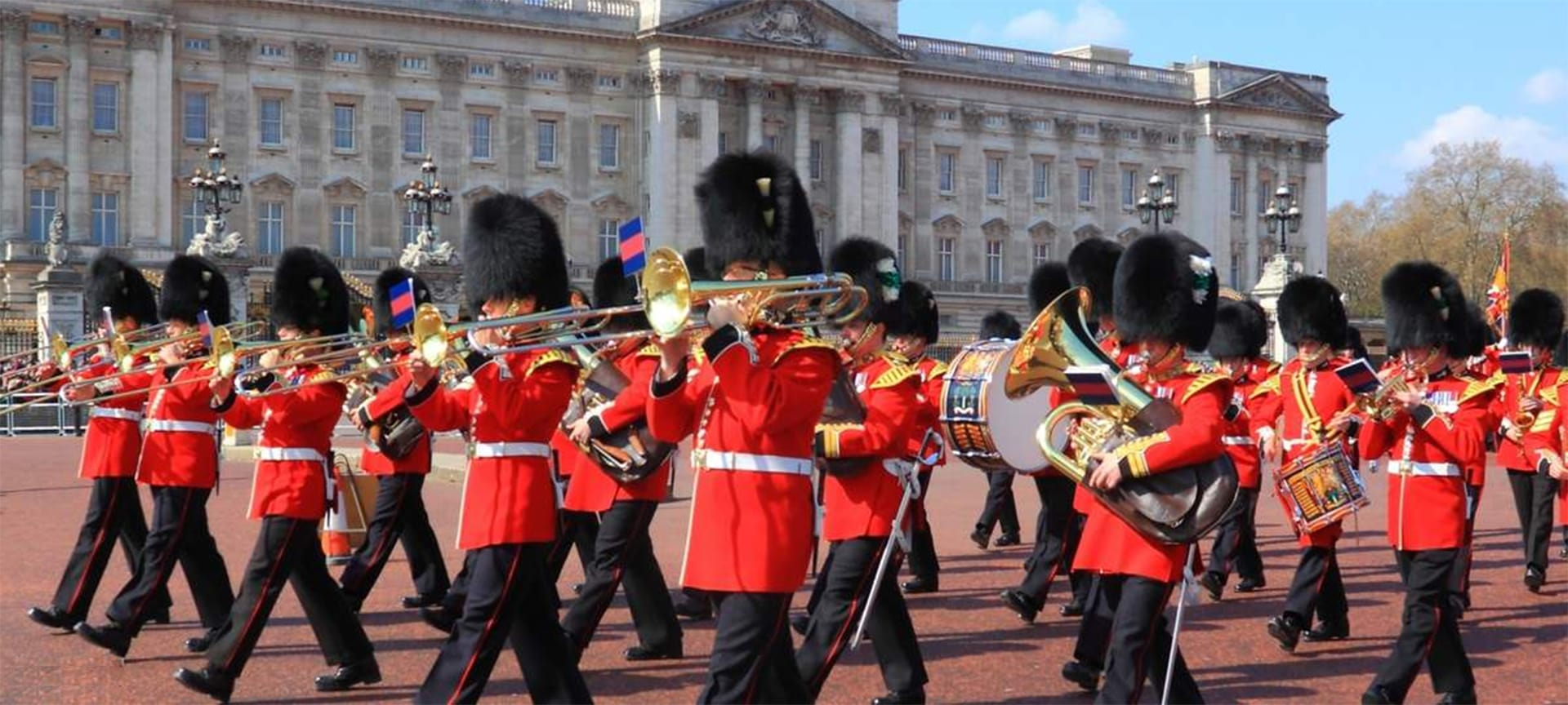 There are few more distinctive sights than the Queen's Guards, whose red uniform and tall bearskin hats are so well known that they've become a symbol of Britain itself. The Changing of the Guard is the moment, filled with pomp and ceremony, when one shift guarding Buckingham Palace relieves the other. The change includes tightly choreographed marching, with the band of the Grenadier Guards in step, adding a sense of occasion to the ceremony with their bombastic mix of horns and drumming.
