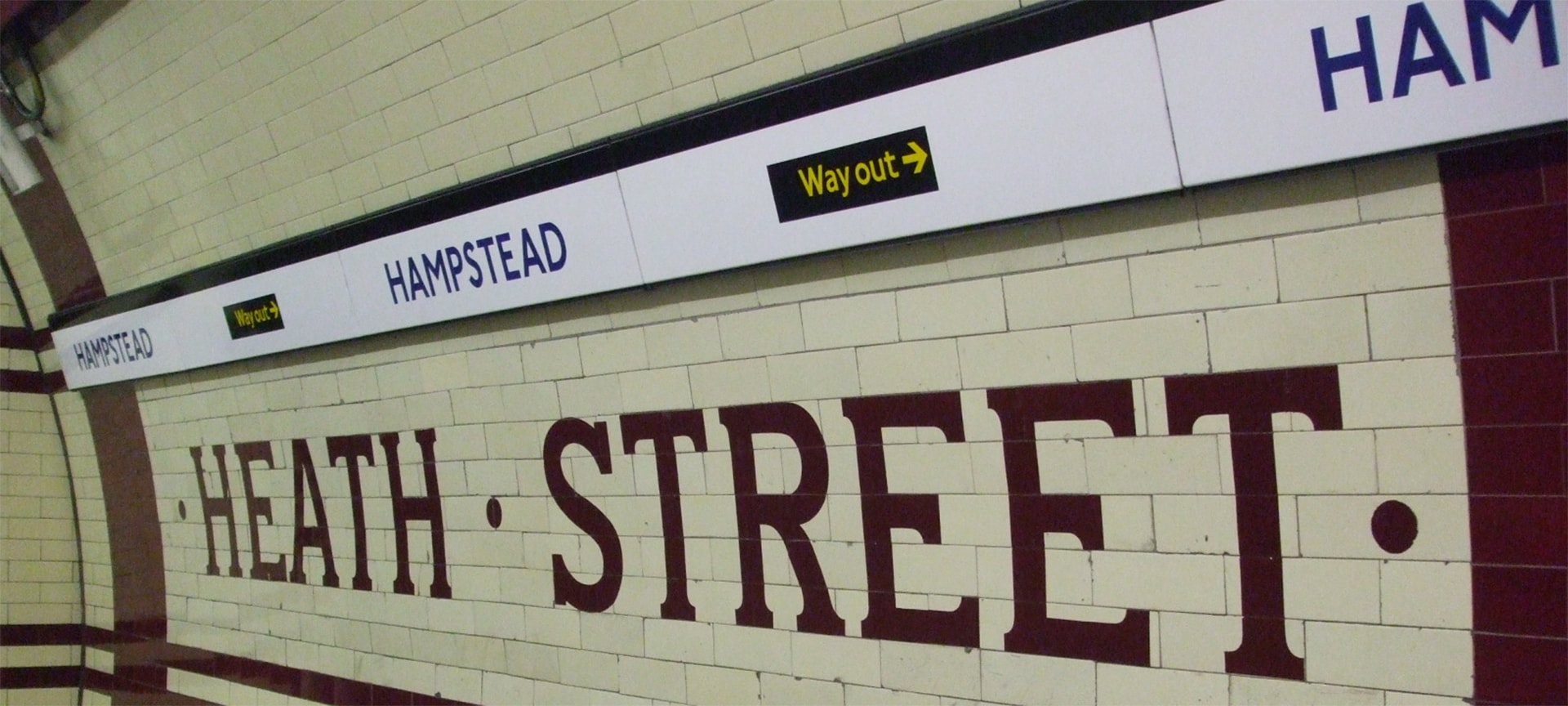 Tiling on the southbound platform of Hampstead Underground station, showing the original proposed name, Heath Street.
