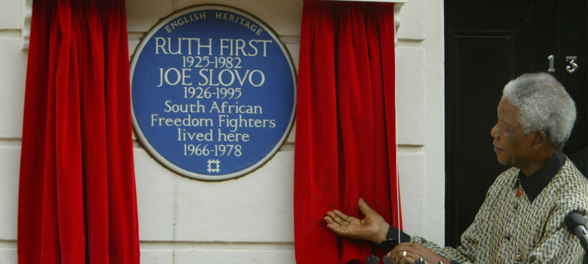 Nelson Mandela received rapturous applause as he unveiled a blue plaque at the former home of two eminent anti-apartheid activists in London. Hundreds of people gathered outside 13 Lyme Street, Camden, north London, as the former South African President paid a personal tribute to Ruth First and her husband, Joe Slovo. Mr Mandela said the couple, who lived there between 1966 and 1978, were