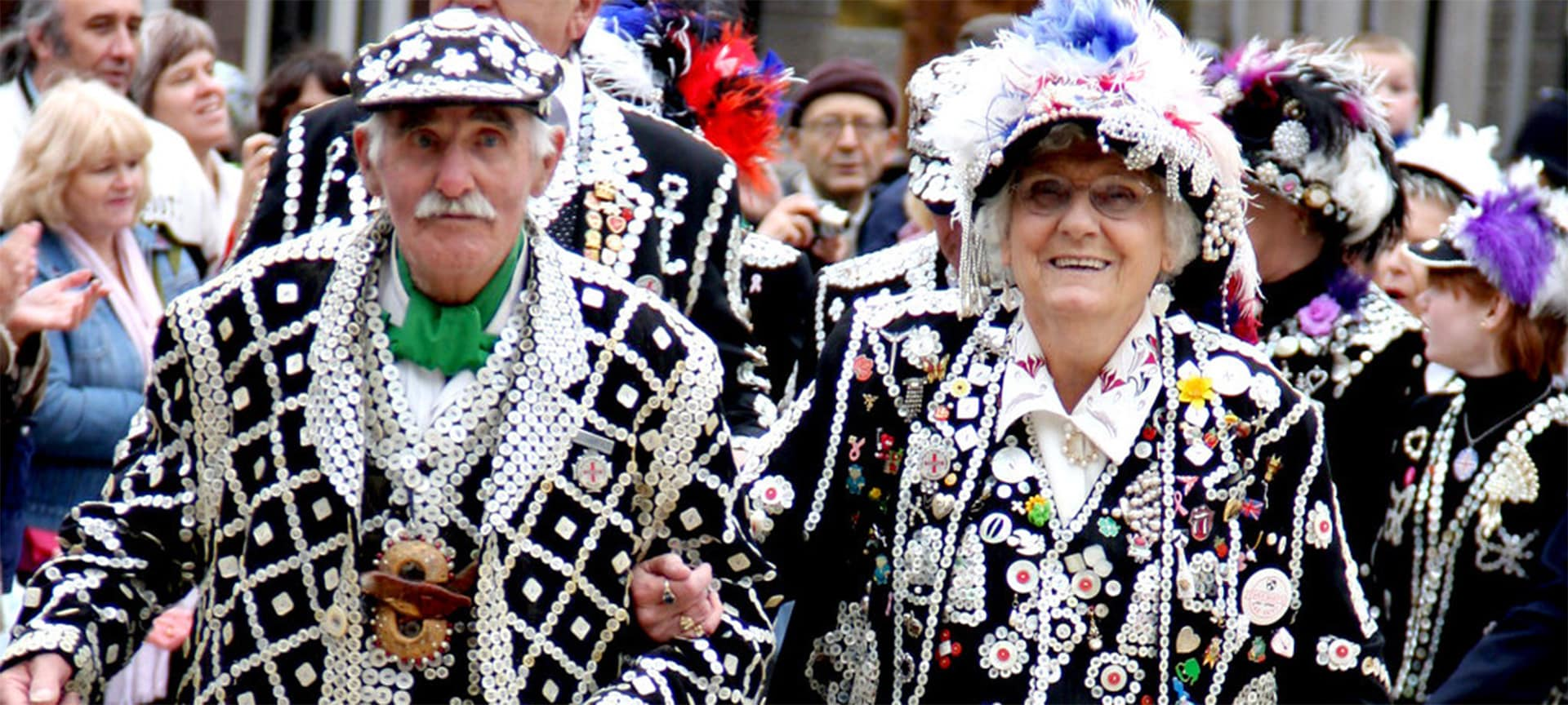 Pearly Kings and Queens are an iconic image of London, easily recognised by their distinctive suits and accessories covered with patterns of mother-of-pearl buttons. They've inspired fashion designers, costume makers, and been featured in everything from films to the London Olympics opening ceremony.
