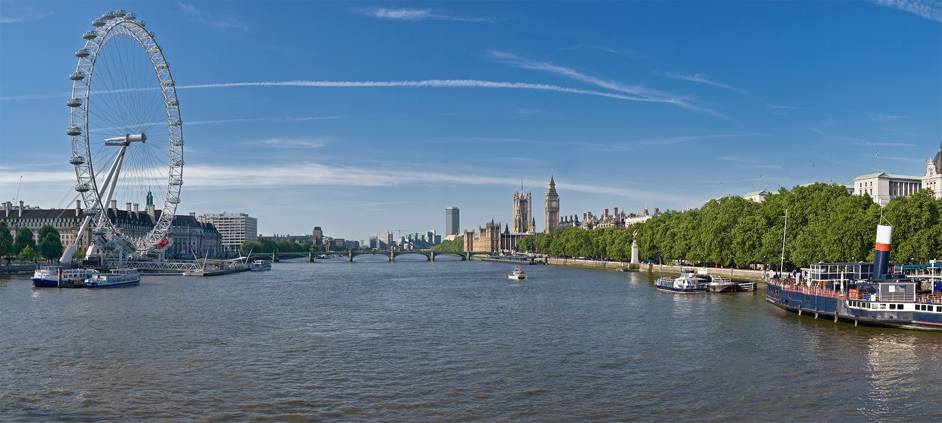 The Thames passes by some of the sights of London - London Eye and its pier to the left, PS Tattershall Castle to the right. In the centre, upstream, Westminster Bridge and Big Ben.