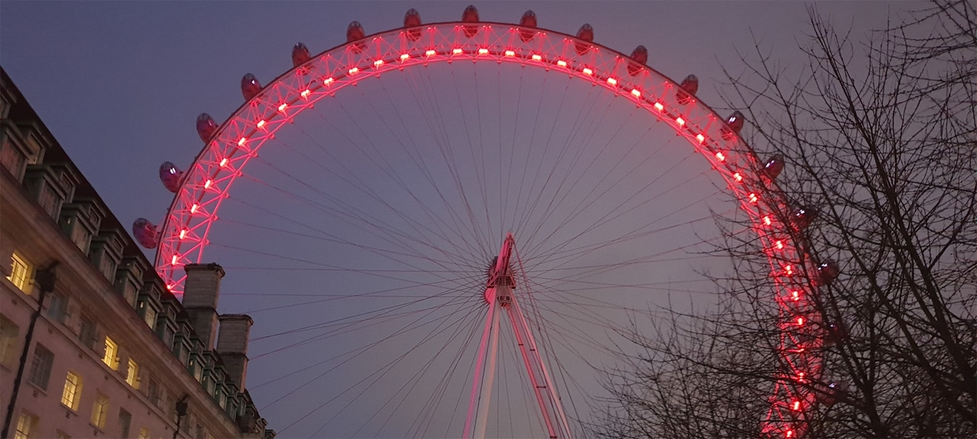 Back in February 2020, the London Eye underwent a striking rebrand. Lastminute.com's sponsorship deal saw the angry red glow people became accustomed to seeing since 2015, make way for a delicious shade of hot pink. Aesthetically, it's be a more soothing sight — slotting in well with the shimmering cool blues of neighbouring buildings along the South Bank.